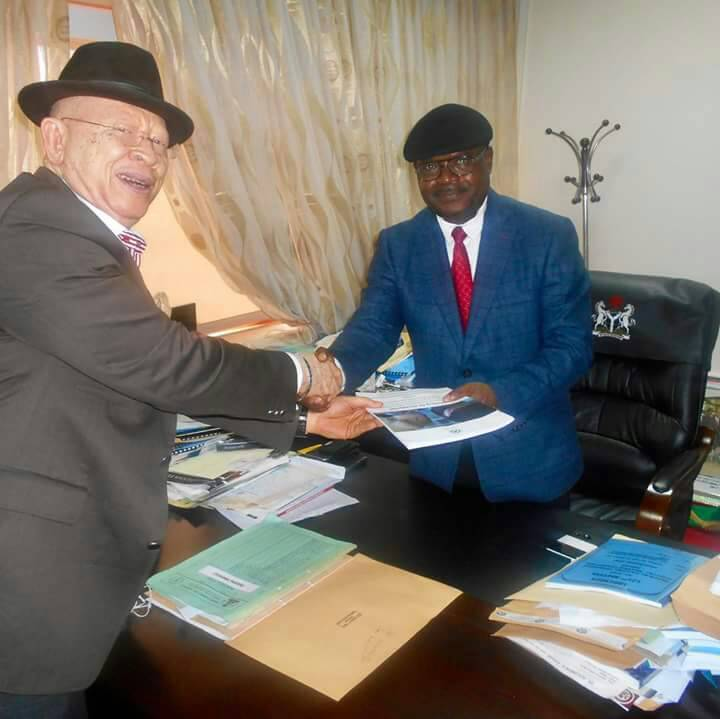 Hon Justice I.U. Bello CJ FCT Abuja receiving IBA albinism Task Force Report for the UN.